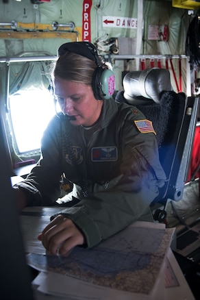 Air Force Maj. Kimberly Spusta collects weather data.