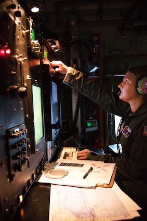 Air Force Maj. Kimberly Spusta collects weather data for the National Hurricane Center.
