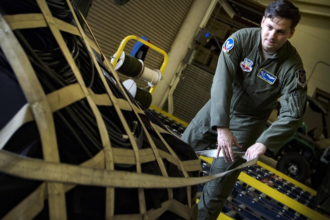 Air Force Staff Sgt. Todd Johnson secures a pallet of equipment in preparation for rescue operations following Hurricane Harvey