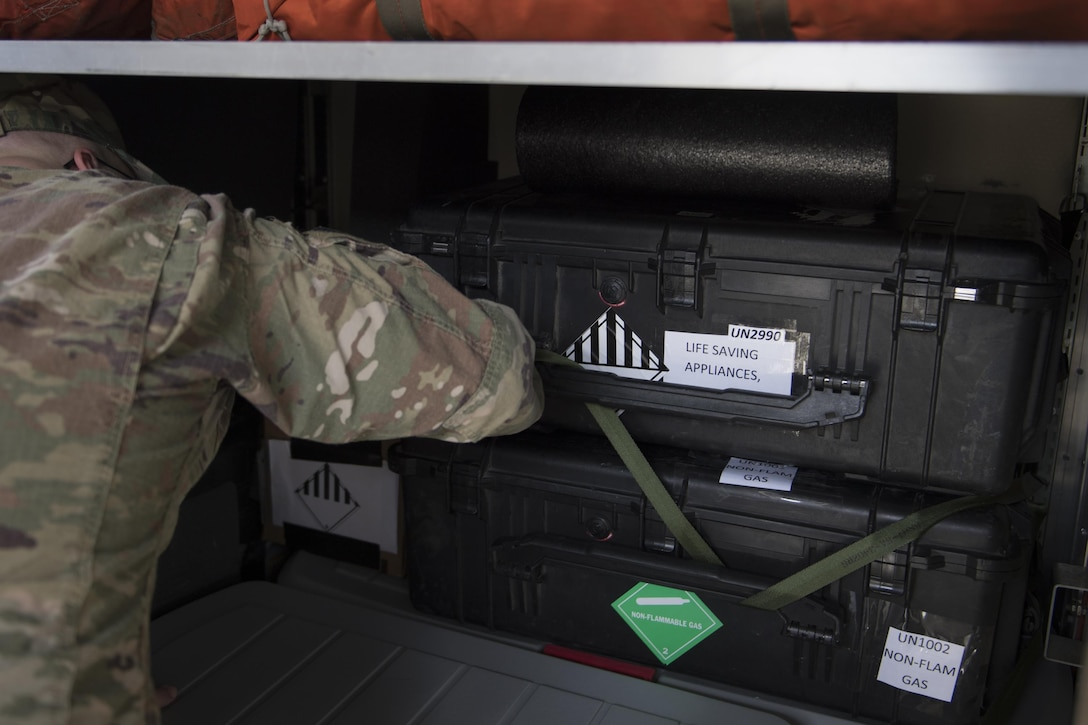 U.S. Air Force Tech. Sgt. Travis Pigford, 347th Operations Support Squadron NCO in charge of the 71st Rescue Squadron aircrew flight equipment section, secures lifesaving gear in preparation for rescue operations following Hurricane Harvey, Aug. 25, 2017, at Moody Air Force Base, Ga.