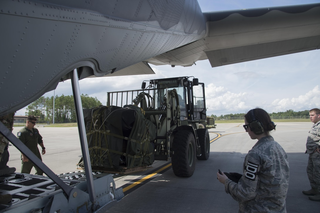 U.S. Air Force members from the 71st Rescue Squadron load gear and equipment in to an HC-130J Combat King II traveling to Texas in preparation of possible hurricane relief support August 26, 2017, at Moody Air Force Base, Ga.