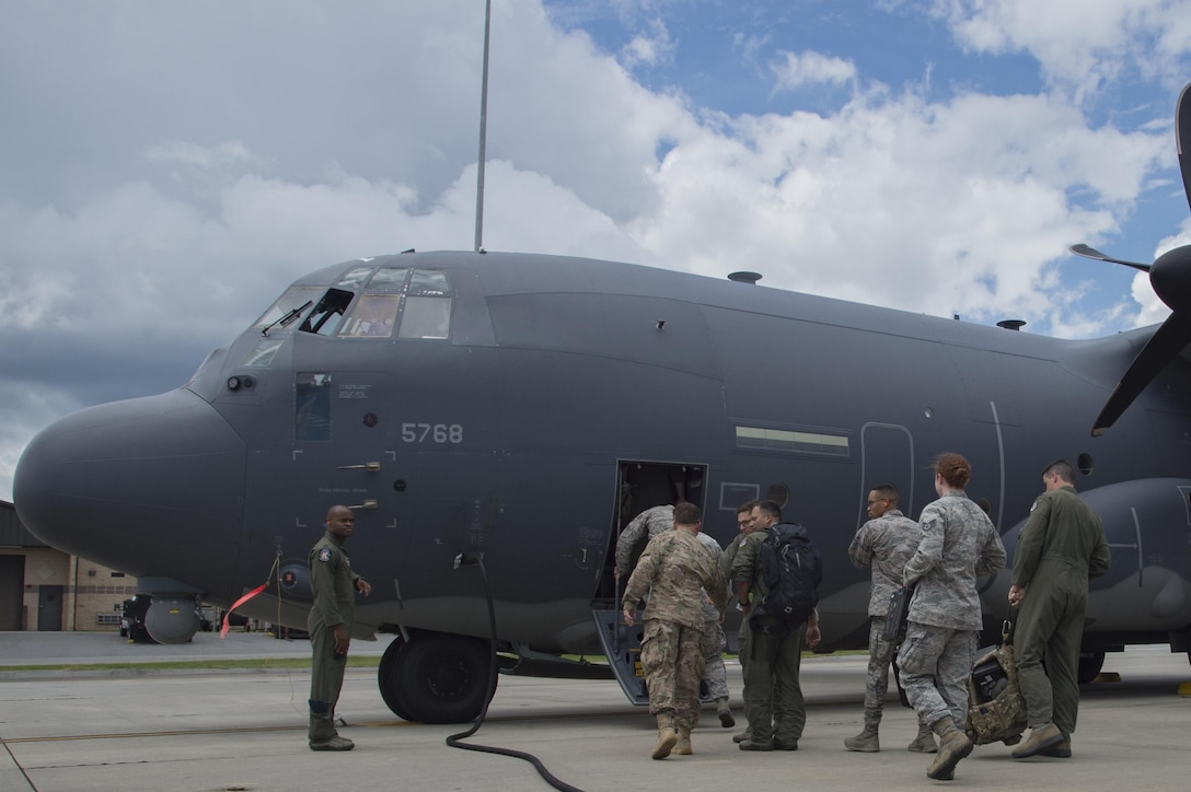 U.S. Air Force members from the 71st and 41st Rescue Squadrons board a HC-130J Combat King II traveling to Texas in preparation of possible hurricane relief support August 26, 2017, at Moody Air Force Base, Ga.