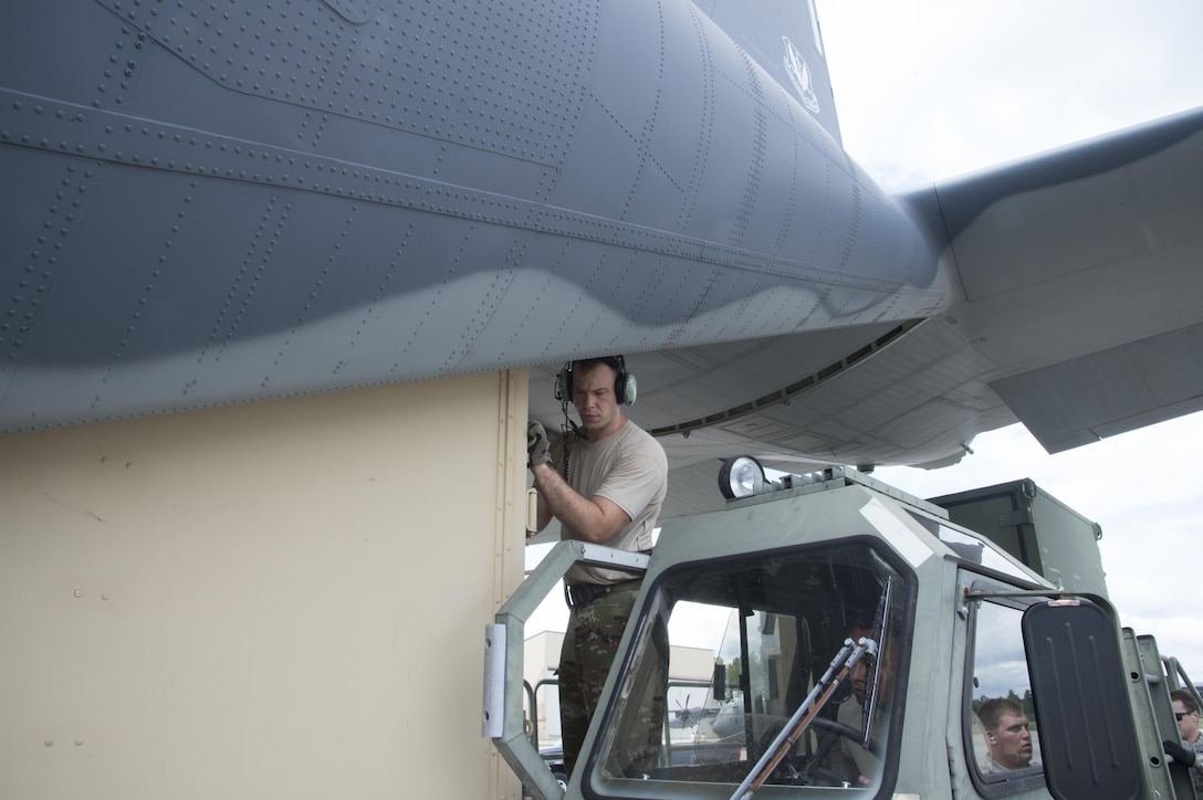 A U.S. Air Force crew chief from the 71st Rescue Squadron pushes a container on to a HC-130J Combat King II traveling to Texas in preparation of possible hurricane relief support August 26, 2017, at Moody Air Force Base, Ga.