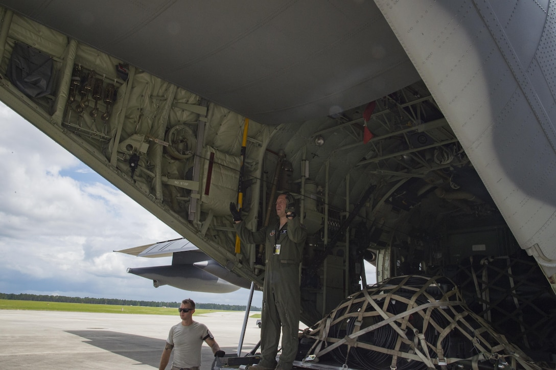 A U.S. Air Force loadmaster from the 71st Rescue Squadron guides a forklift carrying cargo to be transported to Texas in preparation of possible hurricane relief support August 26, 2017, at Moody Air Force Base, Ga.