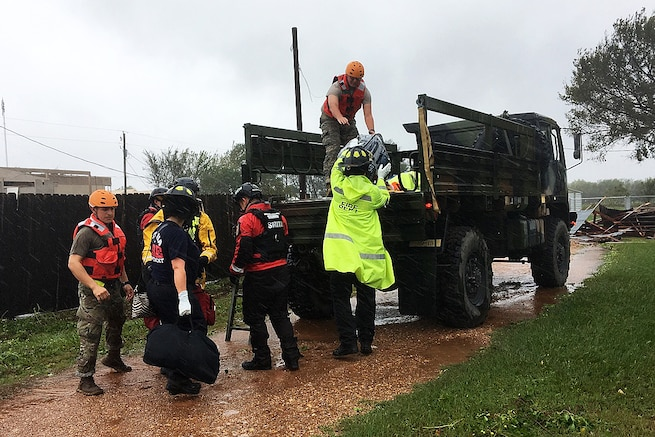 Texas National Guardsmen work with emergency responders in assisting residents affected by Hurricane Harvey flooding.