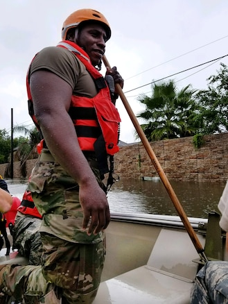 Texas National Guardsmen ride in a boat as they seek to help residents affected by Hurricane Harvey flooding.