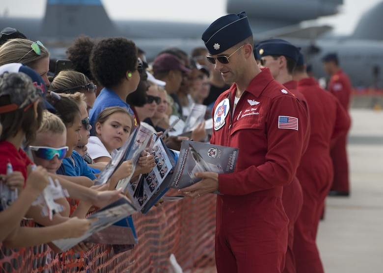 Lt. Col. Jason Heard, commander/leader of the U.S. Air Force Thunderbirds Air Demonstration Squadron and pilot of the No. 1 jet signs autographs after completing a performance during the Thunder Over Dover Open House Aug. 27, 2017, at Dover Air Force Base, Del. The Thunderbirds demonstrated the versatility of the F-16 Fighting Falcon by performing aerial acrobatics, precision formations and high-speed passes during their performance. (U.S. Air Force photo by Senior Airman Zachary Cacicia)