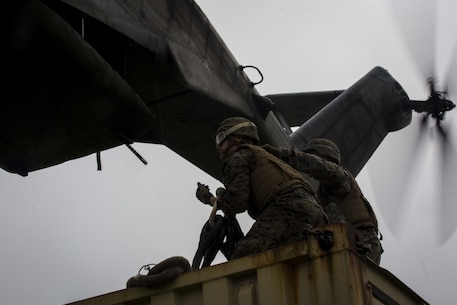 Pfc. Tyler J. Nye (left) and Cpl. Tyler D. Reed (right), both landing support specialist, prepare to attach a container to a CH-53E Super Stallion during external lifts training at Draughon Range near Misawa Air Base, Japan, August 21, 2017, in support of exercise Northern Viper 17. This combined-joint exercise is held to enhance regional cooperation between participating nations to collectively deter security threats. Nye, a Lincoln, Nebraska native, and Reed, a Waukesha, Wisconsin native, are assigned to Combat Logistics Battalion 4, Combat Logistics Regiment 3, 3rd Marine Logistic Group. (U.S. Marine Corps photo by Lance Cpl. Andy Martinez)