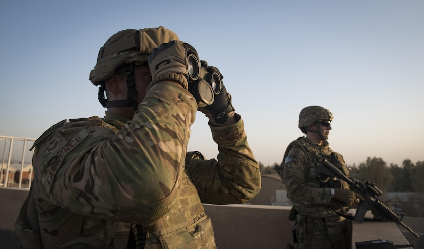 Senior Airman Richard Lawrence, a personnelist from the 451st Expeditionary Support Squadron, provides overwatch at Kandahar Airfield, Afghanistan. Personnelists with the 451st ESPTS in and out-processes all members at KAF, handles decorations and other personnel functions. All Airmen, regardless of position, are responsible for the security and safety of the installation. (U.S. Air Force photo by Staff Sgt. Benjamin Gonsier)