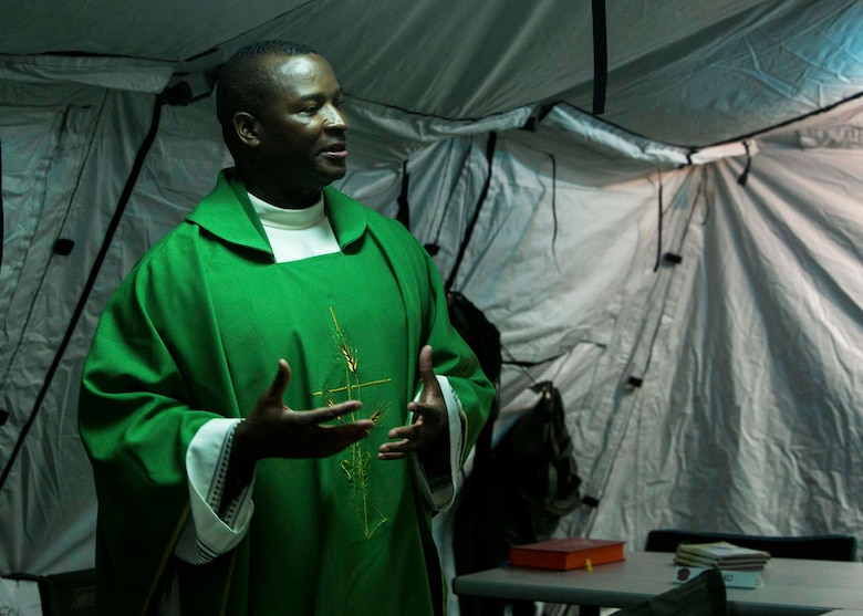 U.S. Navy Lt. Takana L. Jefferson, a chaplain with Battalion Landing Team (BLT) 2nd Battalion, 6th Marine Regiment, 26th Marine Expeditionary Unit (MEU), gives a sermon to Marines as part of religious services during Realistic Urban Training at Camp Davis Training Area, N.C., Aug. 20, 2017.
