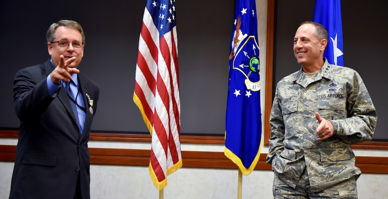 Lt. Gen. Lee K. Levy II, Air Force Sustainment Center commander, and Steven Alsup share a laugh during a farewell ceremony for the AFSC Logistics director on Aug. 25 in the Anaconda Conference Room, Bldg. 3001.
