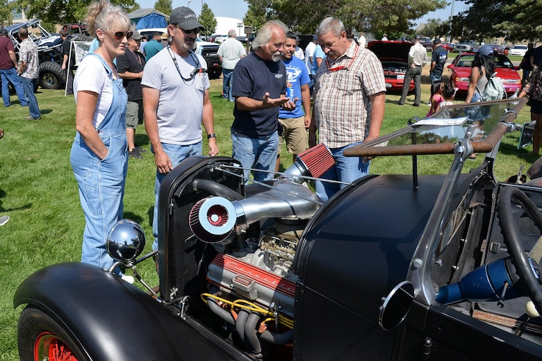"Stanley Bowen, 573rd Aircraft Maintenance Squadron F-16 mechanic (dark shirt), discusses his 1928 Ford Model ""A"" Roadster to gathered onlookers. (U.S. Air Force photo by Alex R. Lloyd)"