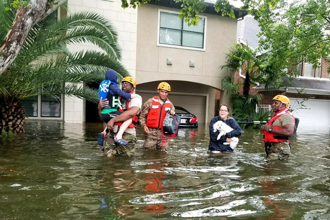 Texas Army National Guardsmen assist residents affected by flooding caused by Hurricane Harvey