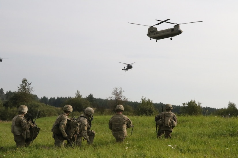 Infantrymen with Company A, 1st Battalion, 8th Infantry Regiment, 3rd Armored Brigade Combat Team, 4th Infantry Division, conduct an air assault.