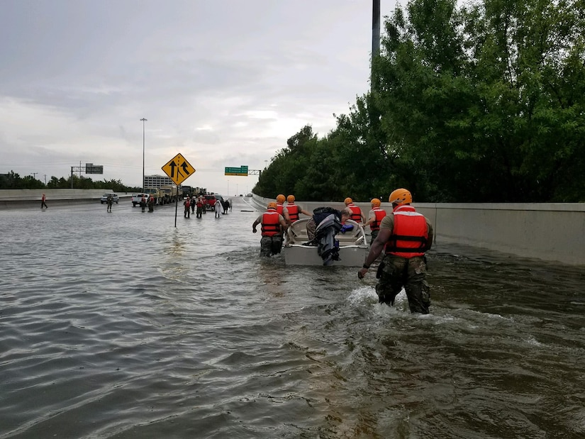 Texas National Guard soldiers arrive in Houston to aid residents in heavily flooded areas from the storms of Hurricane Harvey on Aug. 27, 2017.