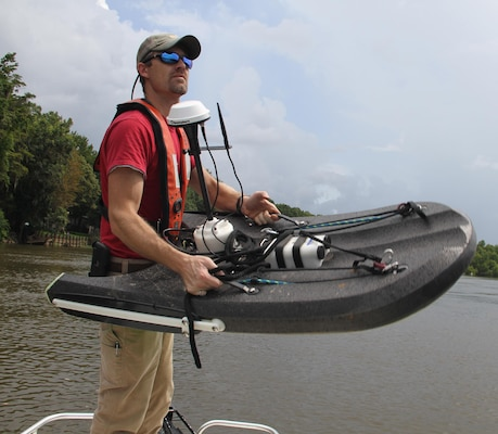 Coastal Engineer Richard Allen an Acoustic Doppler Current Profiler into the Apalachicola River to the broadcast system which provides data communication to the Corps of Engineers into the Apalachicola River near Wewahitchka, Florida for the U.S. Army Corps of Engineers, Mobile District. The data provides feedback to basin managers to make informed decisions within the basin and provides a record of data for environmental compliance. (Photo by Frank Sanchez III)