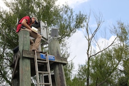 Coastal Engineer Richard Allen reads gauges to the broadcast system which provides data communication to the Corps of Engineers into the Apalachicola River near Wewahitchka, Florida for the U.S. Army Corps of Engineers, Mobile District. The data provides feedback to basin managers to make informed decisions within the basin and provides a record of data for environmental compliance. (Photo by Frank Sanchez III)