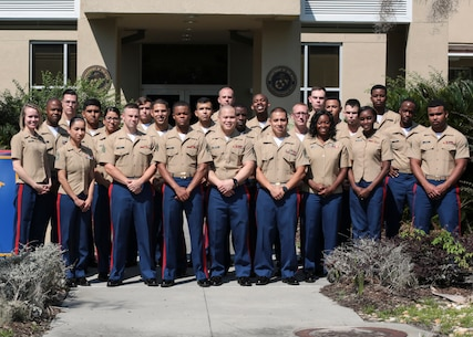 U.S. Marines with 6th Marine Corps District (6MCD) pose for a group photo during the Administrative Conference aboard Marine Corps Recruit Depot Parris Island, South Carolina, August 23, 2017. The conference provided training in a myriad of administrative functions to facilitate all means in order to increase necessary communication and ultimately speed up processing timelines. Administrative Chiefs and clerks from across the District came to the conference to gain additional insight to be effective and have a long term impact to help them support the recruiters in their local area. (U.S. Marine Corps photo by Lance Cpl. Sarah Stegall)