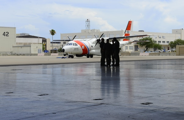 Coast Guard aviation crews discuss flight plans as they prepare for response efforts.