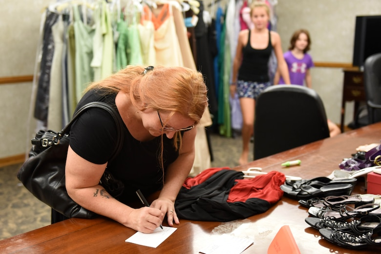Kimberly Jones fills out a form to borrow a dress from the Cinderella's Closet program, Aug. 23, 2017, at Seymour Johnson Air Force Base, North Carolina.