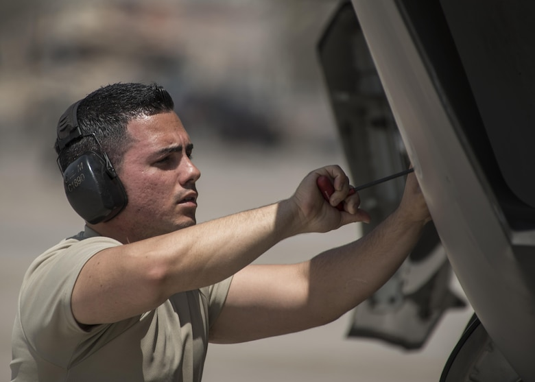 Staff Sgt. Marcos Cruz La Santa, 33rd Aircraft Maintenance Squadron avionics systems technician, closes a maintenance interface panel on an F-35A Lightning II July 18, 2017, at Nellis Air Force Base, Nev. Cruz is one of the first Airmen to become a noncommissioned officer after going through the F-35 training pipeline at Eglin Air Force Base, Fla. Having already experienced the same training first-hand, Cruz and the other core F-35 NCOs are better prepared to lead the fifth generation of aircraft maintainers. (U.S. Air Force photo by Staff Sgt. Peter Thompson)