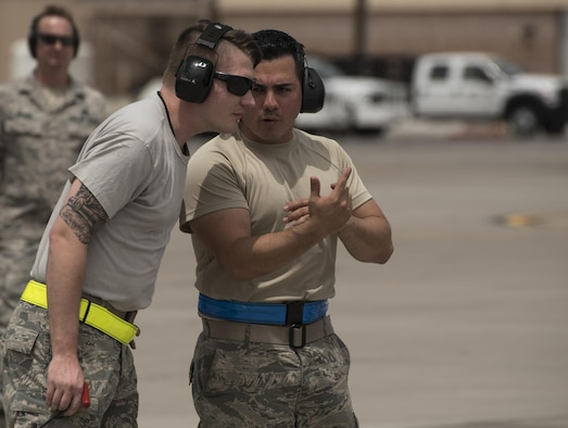 Staff Sgt. Marcos Cruz La Santa, right, 33rd Aircraft Maintenance Squadron avionics systems technician, trains an Airman pre-flight July 18, 2017, at Nellis Air Force Base, Nev. As one of the first core trained F-35 noncommissioned officers, Cruz has the unique perspective of working with fourth-generation maintainers while being able to connect with fifth-generation maintainers who have come through the training pipeline. (U.S. Air Force photo by Staff Sgt. Peter Thompson)