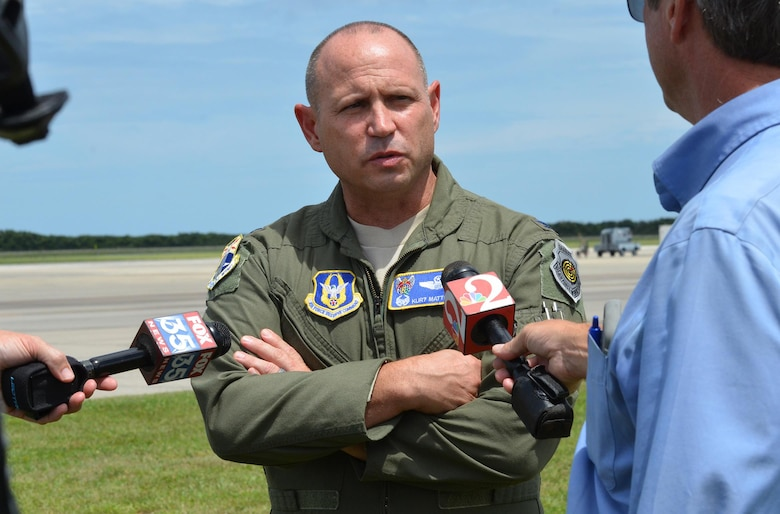 Col. Kurt Matthews, 920th Rescue Wing commander, interviews with media while a group of approximately 90 Citizen Airmen from the 920th RQW, Patrick Air Force Base, Florida, prepared take off for Texas to exercise their hurricane relief capabilities.The contingent included two HC-130P/N aerial refueling aircraft and three HH-60G Pave Hawk helicopters to Naval Air Station Ft. Worth Joint Reserve Base where Tenth Air Force Headquarters is located. If the Federal Emergency Management Agency or Air Combat Command gives the order to provide disaster relief following Hurricane Harvey's devastating effects to the state, the 920th will be ready to help. (U.S. Air Force photo/Maj. Cathleen Snow)