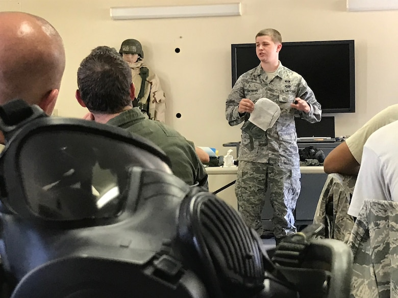 Senior Airman Joseph Bauman, 940th Civil Engineer Squadron emergency management technician, demonstrates use of the M295 Individual Equipment Decontamination Kit during chemical, biological, radiological, nuclear, and high-yield explosives training at Beale Air Force Base, California Aug. 12, 2017. This training prepares Citizen Airmen to survive and work in a hostile environments. (U.S. Air Force photo by Staff Sgt. Brenda H. Davis/Released)