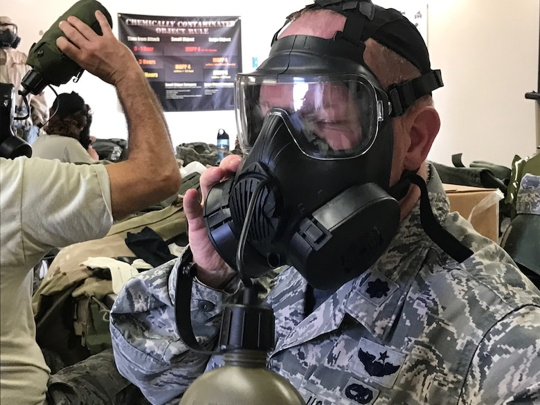 Lt. Col. Joshua Flatley, 940th Operations Support Squadron commander, drinks through his M50 gas mask during chemical, biological, radiological, nuclear, and high-yield explosives training at Beale Air Force Base, California Aug. 12, 2017. This training prepares Citizen Airmen to survive and work in a hostile environments. (U.S. Air Force photo by Staff Sgt. Brenda H. Davis/Released)