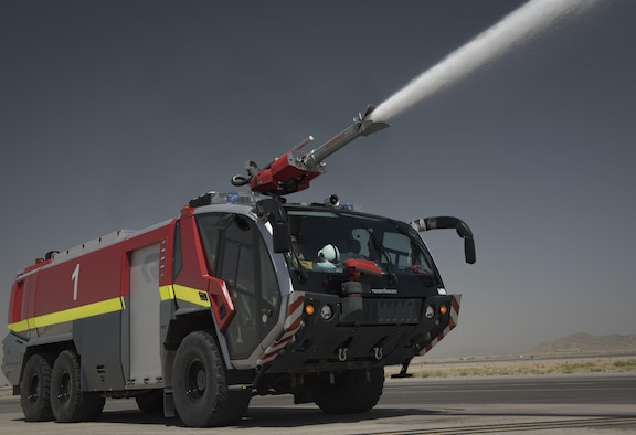 """The fire department is a key component of the 451st Expeditionary Support Squadron at Kandahar Airfield, Afghanistan. The 451st ESPTS is a """"mini-mission support group,"""" containing many of the same elements, just on a smaller scale. The civil engineer element contains engineers who work on the mobile aircraft arresting system, a fire department, pest management and many more functions found in a typical CE squadron. (U.S. Air Force photo by Staff Sgt. Benjamin Gonsier)"""