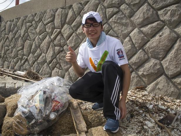 Single Marine Program volunteers cleanup Yuu Beach