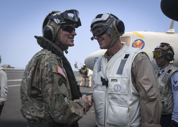 ARABIAN GULF (Aug. 24, 2017) U.S. Navy Rear Adm. Bill Byrne, commander, Carrier Strike Group 11, greets Army Gen. Joseph Votel, commander, U.S. Central Command, upon his arrival aboard the aircraft carrier USS Nimitz (CVN 68), Aug. 24, 2017, in the Arabian Gulf. Nimitz is deployed in the U.S. 5th Fleet area of operations in support of Operation Inherent Resolve. While in this region, the ship and strike group are conducting maritime security operations to reassure allies and partners, preserve freedom of navigation, and maintain the free flow of commerce. (U.S. Navy photo by Mass Communication Specialist Seaman Emily Johnston)