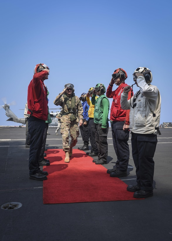 ARABIAN GULF (Aug. 24, 2017) U.S. Army Gen. Joseph Votel, commander, U.S. Central Command, is piped aboard the aircraft carrier USS Nimitz (CVN 68) by  sideboys, Aug. 24, 2017, in the Arabian Gulf. Nimitz is deployed in the U.S. 5th Fleet area of operations in support of Operation Inherent Resolve. While in this region, the ship and strike group are conducting maritime security operations to reassure allies and partners, preserve freedom of navigation, and maintain the free flow of commerce. (U.S. Navy photo by Mass Communication Specialist Seaman Emily Johnston)