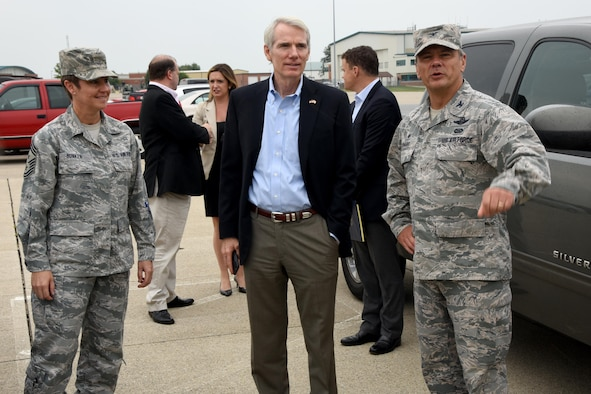 U.S. Sen. Rob Portman is greeted by Col. John Knabel, 178th Wing Commander and Chief Master Sgt. Heidi Bunker, 178th Wing Command Chief Master Sgt. as he arrives at the 178th Wing, Springfield, Ohio for a tour of the wing's facilities Aug. 28.