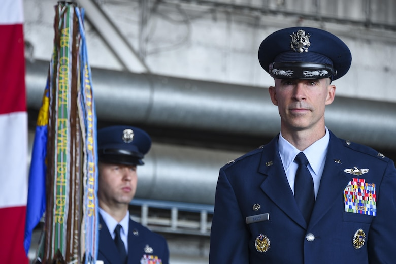 U.S. Air Force Col. Jason Bailey, incoming 52nd Fighter Wing commander, prepares to take command during the wing change of command ceremony in Hangar 1 at Spangdahlem Air Base, Germany, Aug. 29, 2017.  Bailey is a U.S. Air Force Academy graduate with more than 3,000 flying hours in multiple aircraft, including more than 600 combat hours in Iraq and Afghanistan.  (U.S. Air Force photo by Senior Airman Dawn M. Weber)