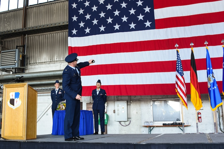 U.S. Air Force Col. Joseph McFall, outgoing 52nd Fighter Wing commander, takes a selfie before relinquishing command to Col. Jason Bailey, incoming commander, during the wing change of command ceremony in Hangar 1 at Spangdahlem Air Base, Germany, Aug. 29, 2017.  Nearly 400 people attended the event to witness the traditional change of command ceremony as Bailey accepted responsibility as the wing commander. (U.S. Air Force photo b Senior Airman Dawn M. Weber)