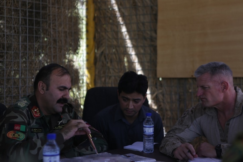 Afghan National Army Brig. Gen. Wali Mohammed Ahmadzai, the commander of 215th Corps, and Brig. Gen. Roger Turner, the commanding general of Task Force Southwest, discuss plans and tactics to secure and clear the Nawa district of insurgents during Operation Maiwand Five Aug. 21, 2017. Several elements of the Afghan National Defense and Security Forces are completing clearing procedures to thwart enemy presence with assistance from U.S. advisors with the Task Force. Denying insurgency and building Afghan governmental influence helps to enhance security and stability for the local populace. (U.S. Marine Corps photo by Cpl. Tyler Harrison)