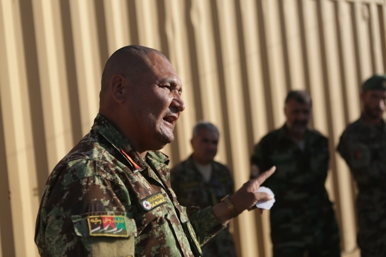 Afghan National Army Col. Abdul Latif, the operations officer of 215th Corps, briefs ANA soldiers on an upcoming mission to clear and secure the Nawa district in Helmand province during Operation Maiwand Five Aug. 21, 2017. Soldiers with 215th Corps have been training to improve their tactics and communication capabilities to enhance combat readiness during missions. U.S. advisors with Task Force Southwest are assisting their Afghan counterparts throughout the operation to deny the Nawa area as a safe haven for insurgency. (U.S. Marine Corps photo by Cpl. Tyler Harrison)