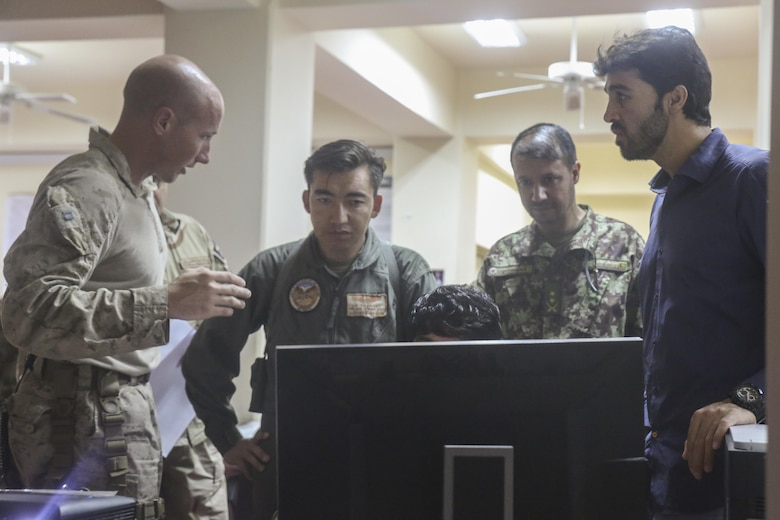 A U.S. Marine advisor with Task Force Southwest discusses tactics and plans with Afghan National Defense and Security Force personnel during Operation Maiwand Five at Camp Shorabak, Afghanistan, Aug. 26, 2017. U.S. forces and ANDSF members are collaborating throughout the operation, with Task Force advisors assisting through battle tracking their counterparts as they clear the Nawa area of enemy presence. The efforts of ANDSF help promote Afghan governmental influence and promote security and stability to the local populace. (U.S. Marine Corps photo by Sgt. Lucas Hopkins)