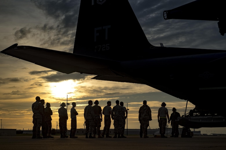 Airmen from the 23d Wing line up to assist with removing cargo from an HC-130J Combat King II, Aug. 26, 2017, at Naval Air Station Fort Worth Joint Reserve Base, Texas.