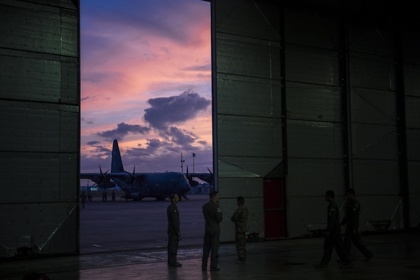 Airmen from the 23d Wing huddle in a staging hanger, Aug. 26, 2017, at Naval Air Station Forth Worth Joint Reserve Base, Texas.