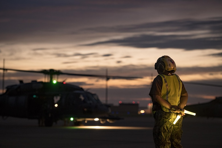 Aviation Metalsmith 2nd Class Difuntorum, marshals an HH-60G Pave Hawk from the 41st Rescue Squadron, Aug. 26, 2017, at Naval Air Station Fort Worth Joint Reserve Base, Texas.