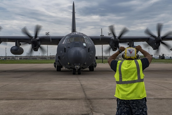 A sailor assigned to Naval Air Station Fort Worth Joint Reserve Base, Texas, marshals a HC-130J Combat King II, Aug. 26, 2017.