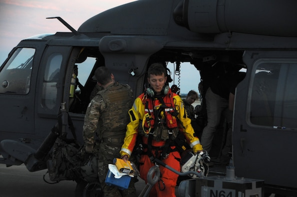 U.S. Air Force Senior Airman James N. Zambik, a pararescueman with the 103rd Rescue Squadron of the 106th Rescue Wing assigned to the New York Air National Guard, exits a HH-60 Pavehawk helicopter at Fort Hood, Texas, August 28, 2017. The efforts of Zambik and the Airmen of 106th helped save 255 people and two dogs during the day's response to Hurricane Harvey. (U.S. Air National Guard photo/Airman 1st Class Daniel H. Farrell)
