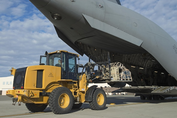 Airmen of the Alaska Air National Guard's 176th Wing load and secure cargo onto a Joint Base Elmendorf-Richardson C-17 Globemaster III at JBER, Alaska, Aug. 28, 2017. The Airmen will travel to Houston, Texas as part of a humanitarian mission in response to Hurricane Harvey. (U.S. Air Force photo by Senior Airman Javier Alvarez)