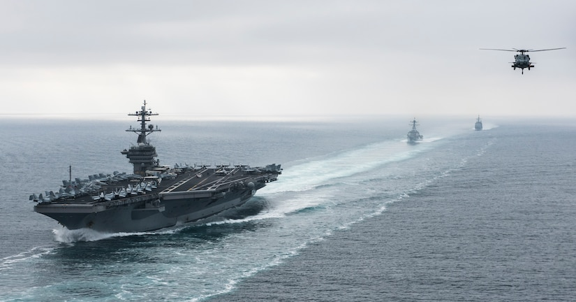 The aircraft carrier USS Theodore Roosevelt, the guided missile destroyer USS Halsey, and the guided missile cruiser USS Bunker Hill steam in formation during a strait transit show of force exercise in the Pacific Ocean, Aug. 11, 2017. The ships were preparing for an upcoming deployment. Navy photo by Petty Officer 2nd Class Paul L. Archer
