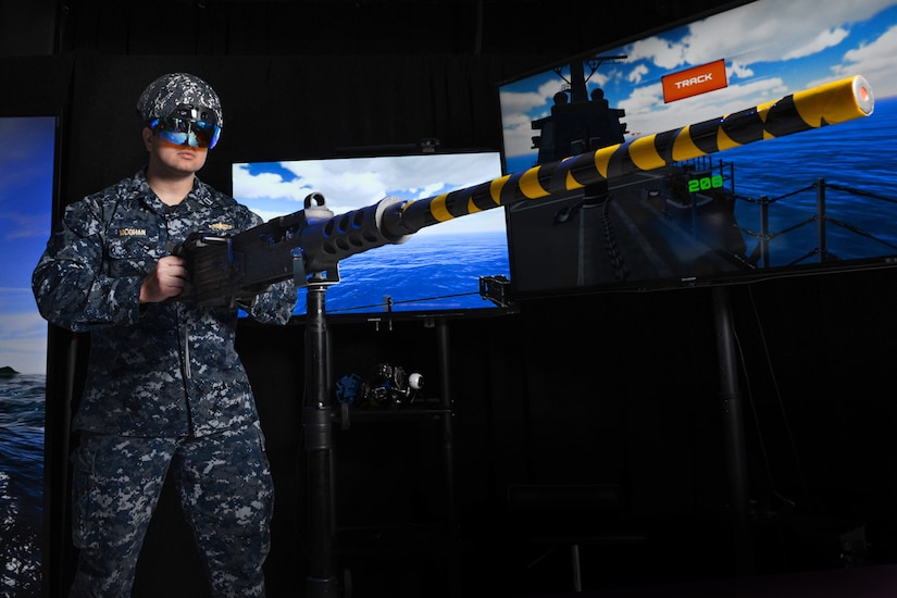 Navy Lt. Steven McGhan demonstrates a gun-augmented reality system, which was developed at the Space and Naval Warfare Systems Center Pacific in San Diego, Dec. 14, 2016. Navy photo by Alan Antczak