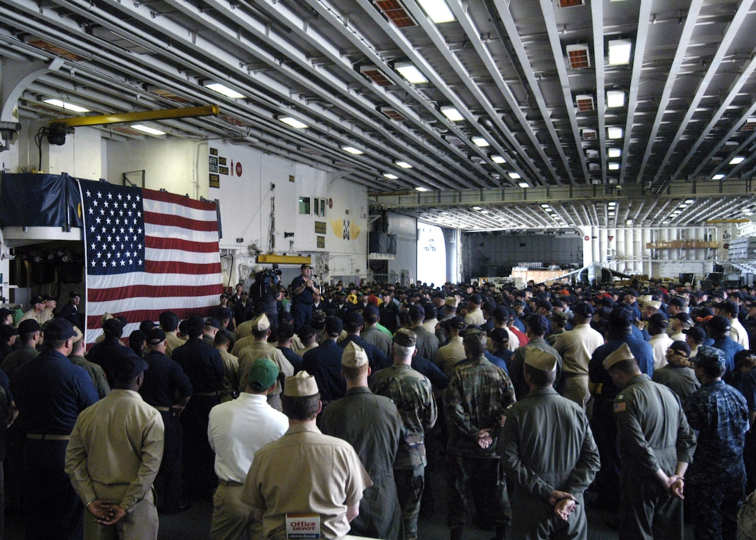 In September 2005, U.S. Coast Guard Vice Admiral Thad Allen, principle federal official for the federal response to Hurricane Katrina, addresses the crew of the USS Iwo Jima. The Navy's involvement in the humanitarian assistance operations were led by the Federal Emergency Management Agency in conjunction with the Department of Defense.