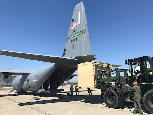 California Air National Guardsmen from the 129th Rescue Wing, Moffett Air National Guard Base, Calif., prepare to board a C-130J aircraft from the 146th Airlift Wing, Channel Island Air National Guard Station, Calif., in support of Hurricane Harvey, August 28, 2017.