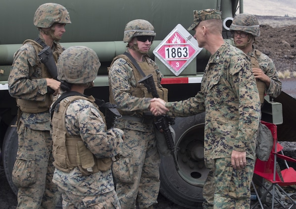 POHAKULOA TRAINING AREA, HAWAII – Col. Michael Styskal, the commanding officer of 3rd Marine Regiment, meets with bulk fuel specialists at the forward arming and refueling site for Exercise Bougainville II at Pohakuloa Training Area, Aug. 21, 2017. Exercise Bougainville II prepares 3rd Battalion, 3rd Marine Regiment for service as a forward deployed force in the Pacific by training them to fight as a ground combat element in a Marine Air-Ground Task Force. (U.S. Marine Corps photo by Lance Cpl. Luke Kuennen)